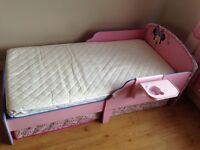 Toddler bed - Minnie Mouse - including mattress, underbed storage and detachable shelf.