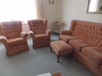 Three seater sofa, two armchairs and footstool