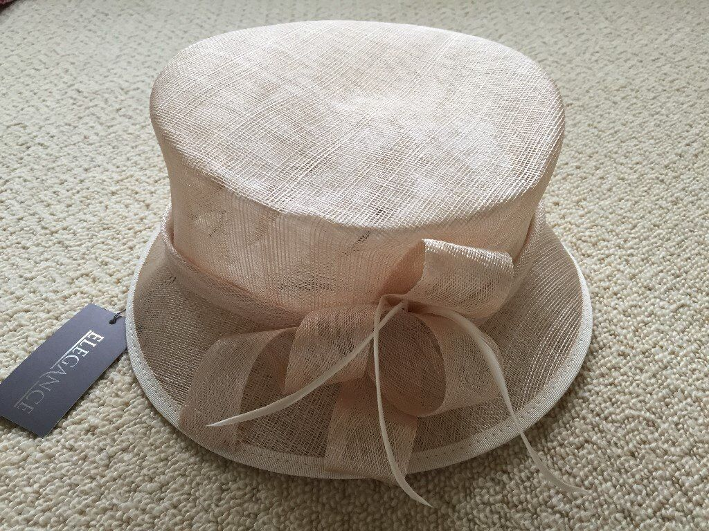 New ladies hat in natural shade ideal for wedding or special occasion