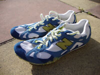 New Balance running spikes, size uk 9 plus spare 7mm spikes & key.