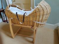 Moses basket / wicker crib. Mamas & Papas comes with with rocking stand, mattress and sheets
