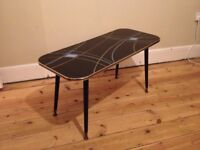 A stylish 50's coffee table with atomic legs for sale