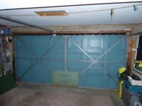 Electric Double Garage Door In Full Working Order. Inc Motor The size is 14 Ft x 6Ft - 6Ins