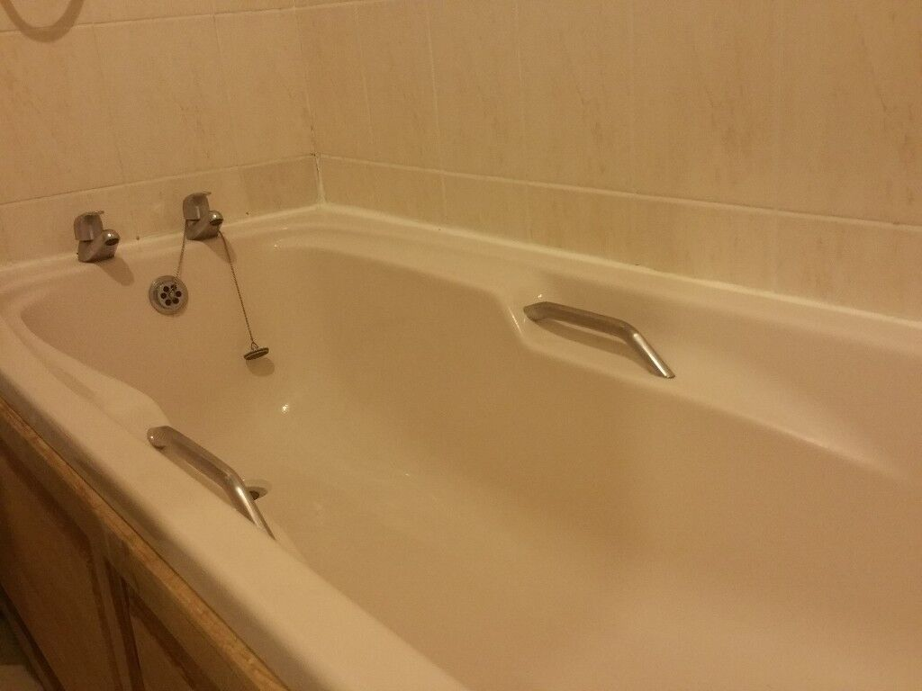 Acrylic Bath in Champagne, with chrome handles and raised grips ...