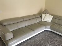 Leather corner couch and swivel chair