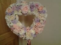 Wedding decoration. Heart shape tree with silk flowers in shades of pink, cream, lavender and ivory