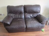 Brown leather 2 seater sofa with reclining footstalls