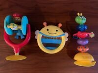 Two highchair toys and one sensory toy