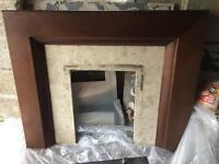 Dark brown wood and cream marble fireplace