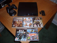 Ps3 slim 500gb - controller - charger stand and 5 games ( no box )