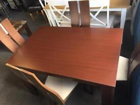 Dark brown wooden table with 4 chairs