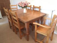Lovely farmhouse style pine table and 6 oak chairs
