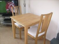 COMPACT DINING TABLE AND 2 CHAIRS IN GOOD CONDITION