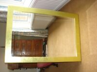 Mirror with gold frame, bevelled glass