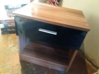 Bedside table with black gloss finish drawer front. Very good condition.