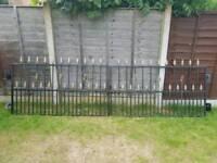 Metal driveway gates and wall railing