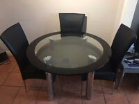 Excellent Condition Round Glass Dining Room Table with 4 black matching leather chairs