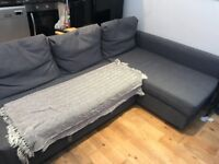 IKEA Corner sofa bed with storage.