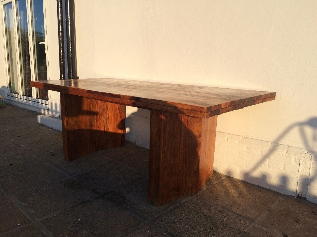 Solid Dark Wood Dining Tablein Sandwich, KentGumtree - Solid hard wood dining table in excellent condition originally purchased from Harveys at over £1750. Table top removable from two legs for transportation table top weight in excess of 50kgs. Length 2100mm x Width 920mm x Height 720mm. In excellent...