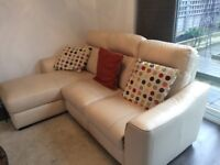 Cream Leather Reclining Sofa and Arm Chair