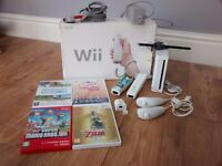 Nintendo Wii Console, 2 Controllers, 2 Nunchucks, 4 Games, Motion Plus Adapter