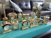 A SELECTION OF BRASS MINATURE CLOCK'S.