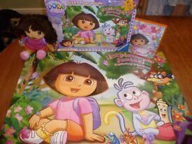 Dora The Explorer soft doll, 24 piece floor jigsaw, clock and DVD