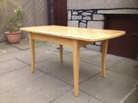 Solid wood extending dining table. Chairs also available.
