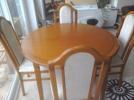 Table with fabric covered chairs, excellent condition, buyer collects.