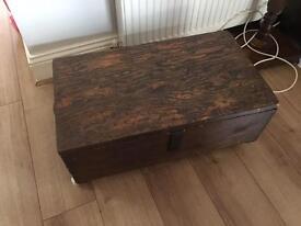 Solid dark wood coffee table vintage chest box wheels