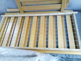 Wooden baby cot, ideal for small bedrooms