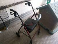 Four wheeled walking aid with seat