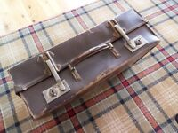 OLD SUITCASE WITH VINTAGE MUSIC SHEETS