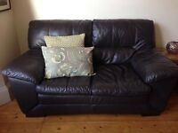 X2 brown leather two seater sofa and X1 armchair, excellent condition, 1 year old
