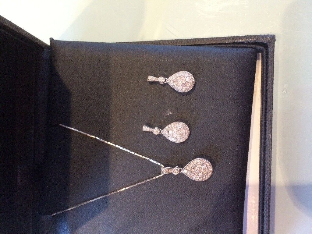 Diamond pendant and drop earrings for pierced ears in white gold. Worn once cost £800 new