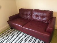 Dark red faux leather sofa