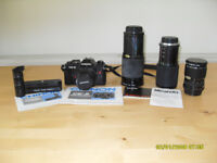 Old 35mm SLR camera with powerdrive and 3 additional zoom lenses