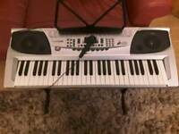Keyboard with stand and note stand