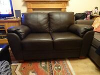 2 Seater Dark Brown Leather Sofa. Hardly used. Excellent condition.