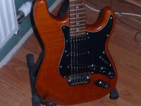 Hamer Slammer Series. Great sounding and quality wood body.