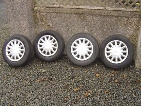 4 x Ford Fiesta Steel wheels with as new tyres and wheel trims 165x70x13 £60