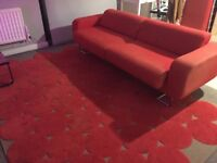 Stylish Bright Red 3 Seater Sofa (RRP 500.00) and Large IKEA Rug