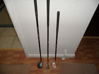 golf clubs and automatic putting machine