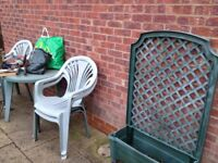 Green , but is faded by sun , solid plastic table and 4 chairs with garden planter screen