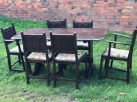 Ercol dark solid wood table and six chairs