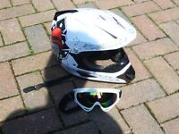 motor cross helemet boots goggles and shin pads triangle and fork surport