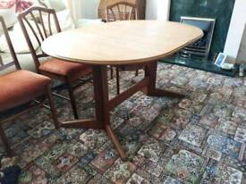 Teak oval extending dining table with 6 chairs