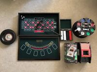 Poker Chips, Roulette wheel, and 2 card shufflers