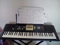 Yamaha YPT 220 keyboard with stand and music book