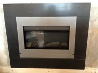 Electric flame effect fire with slate surround.